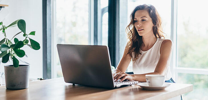 woman-working-on-her-laptop